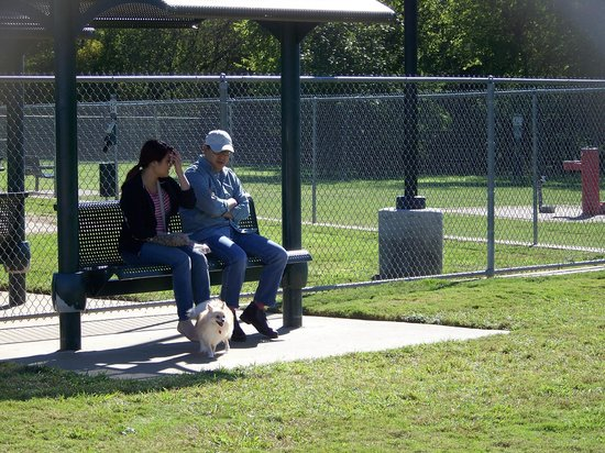 Covered benches in small dog section - - Tails and Trails dog park