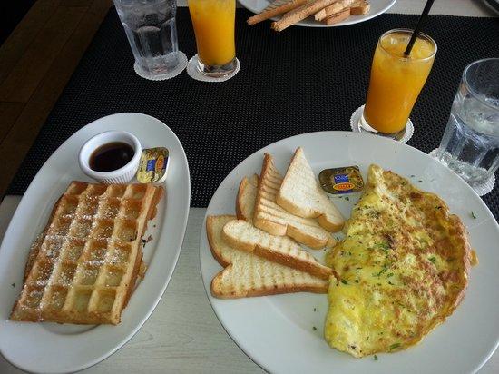 Taste of Belgium Restaurant: Fluffy omelet and waffle Belgium style.