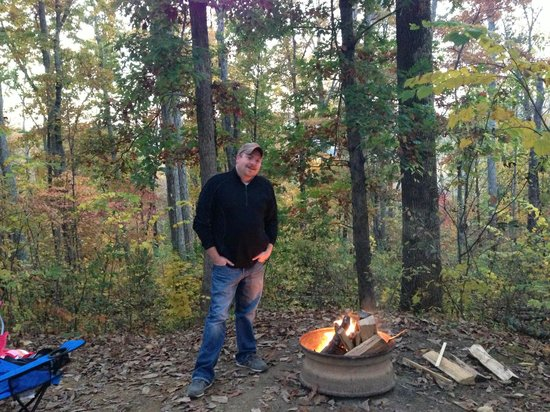 Lookout Mountain / Chattanooga West KOA: tent site E.  view and fire pit.  This is one bundle of wood.