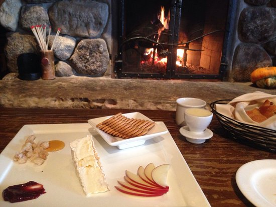 Maggie's Pub: Cheese plate on the couch by the fire