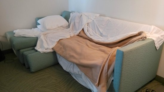 SpringHill Suites Houston Baytown: Alternative to Sleeping on Wornout Mattress - Carefully remove pillows from Sofa and use Sofa as