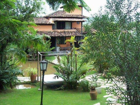 Pousada Le Palmier: jardin de LE PALMIER