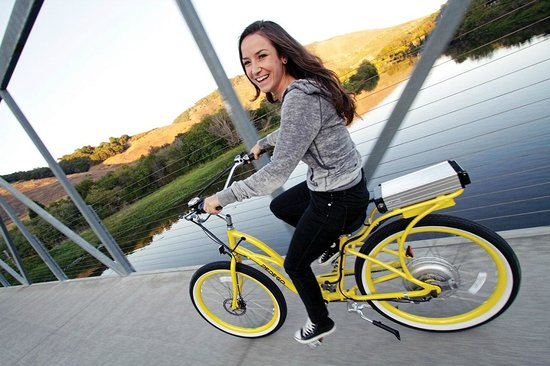 Pedego Electric Bikes: A young woman on a bright yellow Pedego electric bike, touring the central California area