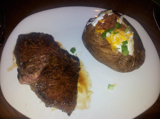 Outback Steakhouse: Sirloin steak and loaded baked potato.