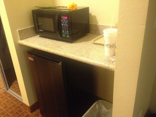 Ramada College Station: Counter with microwave and fridge under