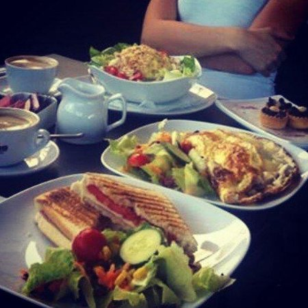 """Oblico Cafe: And it's """"just"""" a breakfast,chicken salad,toast with ham&cheese ,and huge omelette..Delicious!!!"""