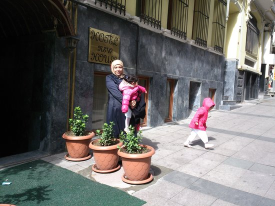 Hotel New House: my family beside the hotel entrance