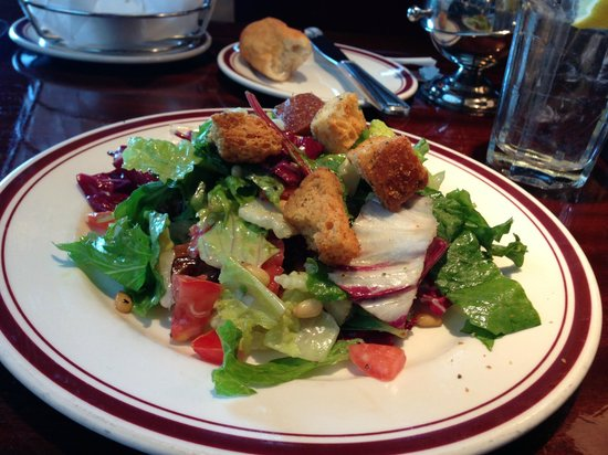 Mike's American Grill : Mixed Greens Salad with tomato, sun dried cranberries, dates, pine nuts & champagne vinaigrette.