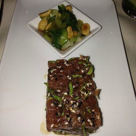 [m]eatery bar + restaurant : Tuna tartare with too much marinade, killing the fragile taste.