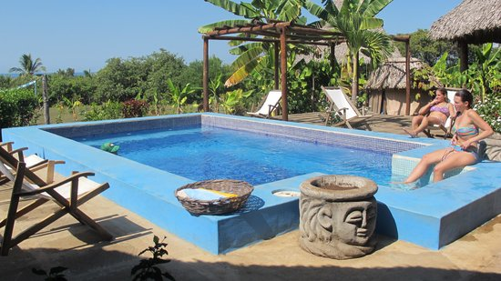 Surf With Amigas- Women's Surf and Yoga Retreat: Poolside at Coco Loco