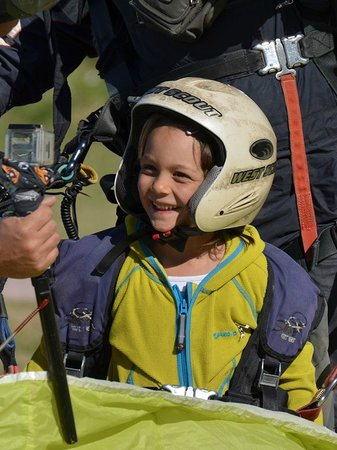 Reaction Paragliding: a happy child suddenly after the flight