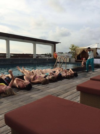 The ONE Legian: Lining up for free shots during pool party!