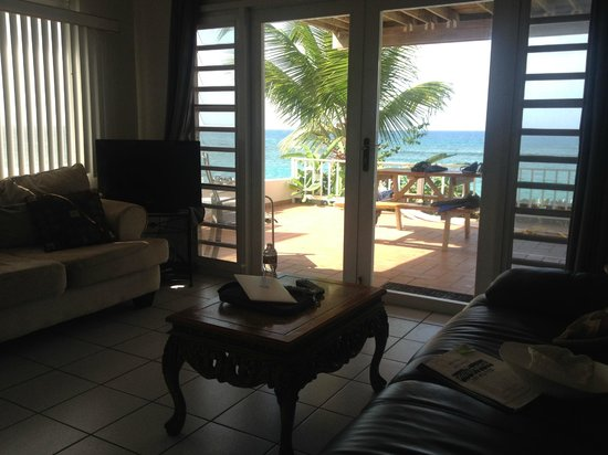 Villa Tropical Oceanfront Apartments on Shacks Beach: View from inside the apartment toward the beach