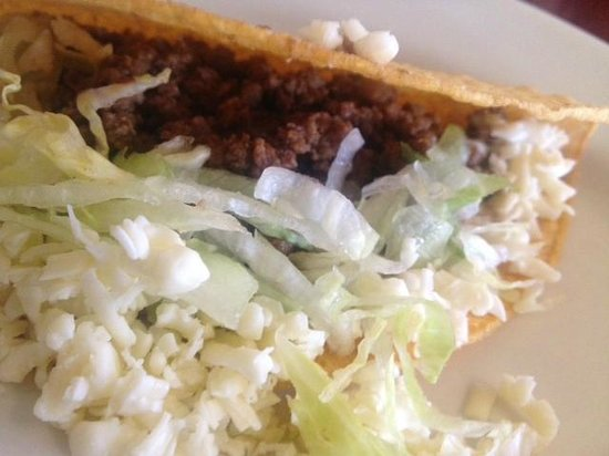Tequila Mexican Restaurant: Beef buried in taco by overflowing lettuce and cheese