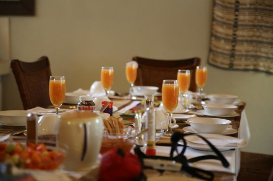 Liz at Lancaster Guesthouse: breakfast tables set beautifully every day. We have added birthday banner.