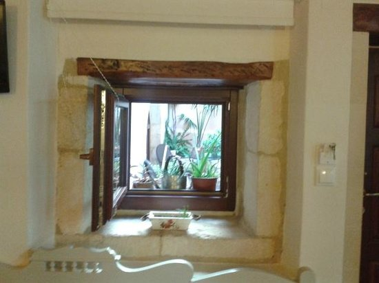 Casa De Delfini: view through window