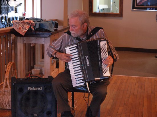 Archtop Cafe: Our resident Accordion player usually playing at Archtop Sunday mornings