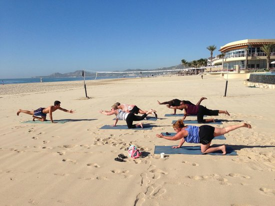 The Grand Mayan Los Cabos: Activities include yoga on the beach