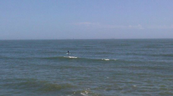 Galveston's 61st Street Fishing Pier: Paddle boarder