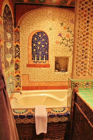 Inn of the Five Graces: Tiling around the bathtub