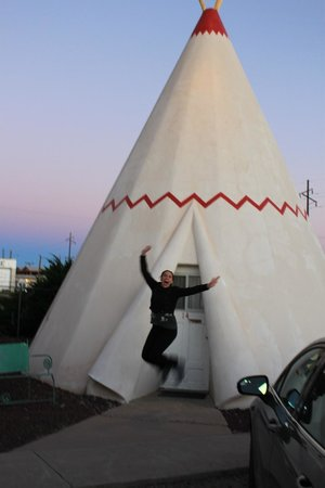 Wigwam Motel: Jumping for joy in front of our wigwam.
