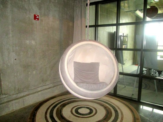 NYLO Plano at Legacy: Fun lobby chair, with partial view of lobby meeting space.