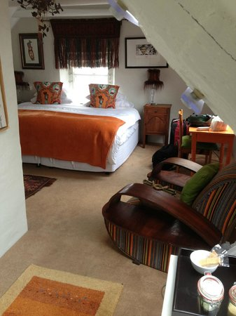 ah! Guest House: Orange room with chair & small table & Superking bed