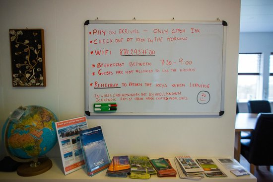Like Vik Guesthouse: white board for guests with tourism pamphlets