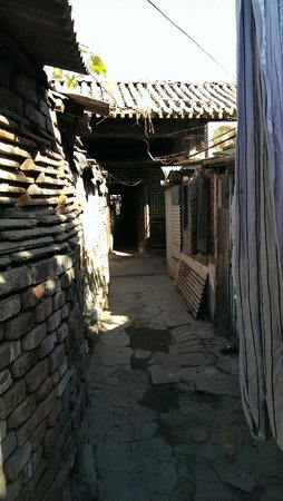 Stretch-A-Leg Travel-Day Tour: Visiting the fee authentic hutongs left