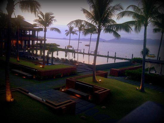 Hansar Samui Resort: a view of the pool and n the restaurant on the extreme left.