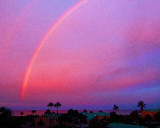 Ocean Village: Sunset & Rainbow over Cayman Pool