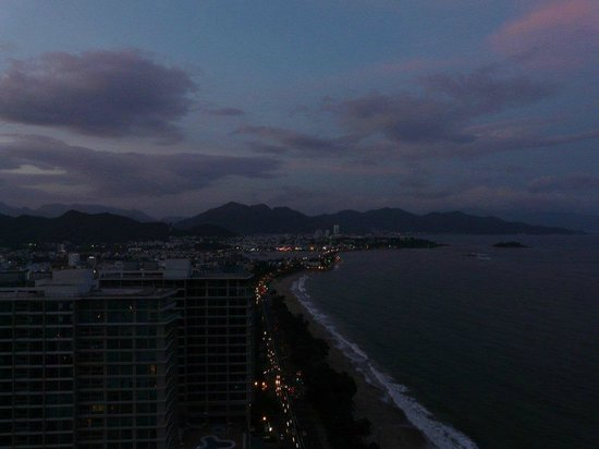 Sheraton Nha Trang Hotel and Spa: along the coast to the left of the hotel at dusk
