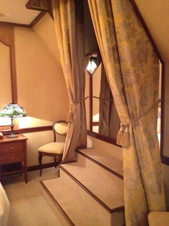 Hotel de Vendome : Stairs to window in bedroom.