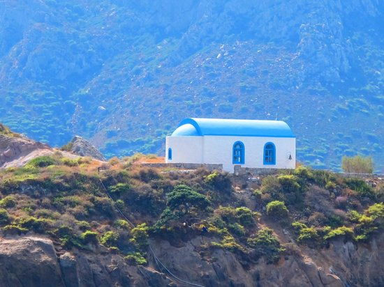 Agios Stefanos Beach, over the sea church