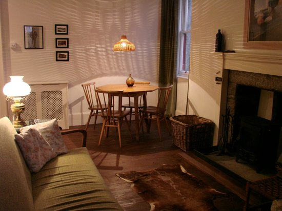 Dell of Abernethy Cottages: Little Dell cosy living room with woodburner
