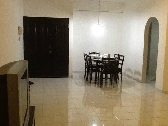 Noble Villa Apartment: Spacious dining and sitting room, with a big kitchen through the doorway on the right.