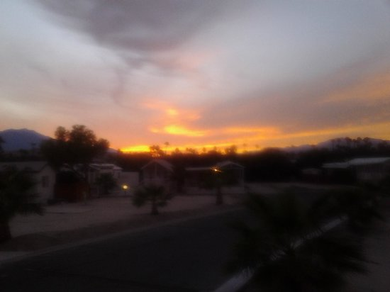 Caliente Springs Resort-Active 55+ Yrs and Better Resort: The sunset view from the front patio of our RV