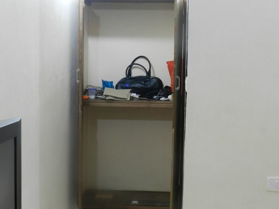 Nisarg Tourist Home: a basic cupboard with no hangers