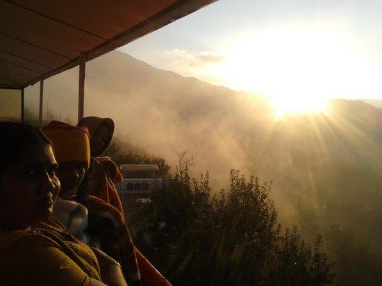 Krish Rauni : sunrise view from the resort's sunroom