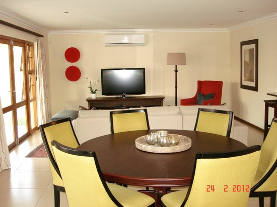 Topaz Cove Luxury Villas: View of living area from dining room. Each villa has a flat screen TV in the lounge
