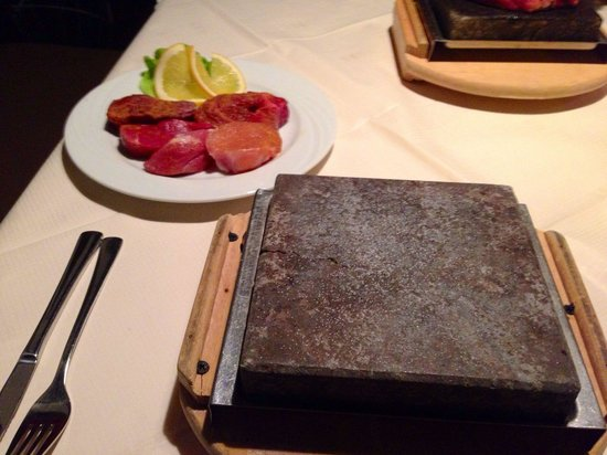 Corner Steakhouse: A mix plate of meat, with hot-stone for self service cook.