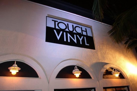 Touch Vinyl: Our sign is hard to see behind the palm trees, but sometimes it is lit up!