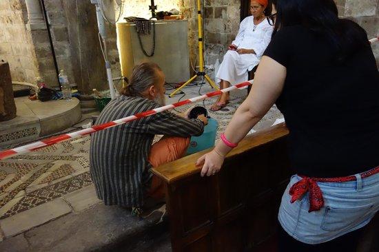 Church of San Cataldo: man doing restoration work