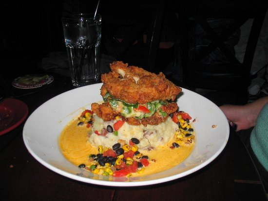 Bahama Breeze: Buttermilk Fried Chicken Breast Layered with spinach, tomatoes and melted cheese over hand-mashe