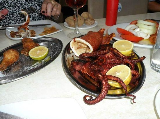 Restaurante El Cine: canary potatoes, squid, octopus, tomato & onion salad, and house rose wine
