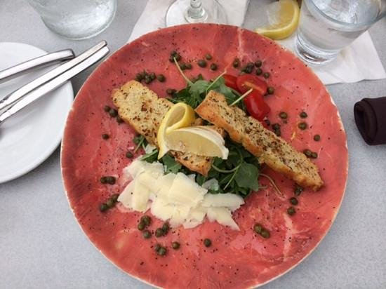 Island Way Grill: Beef carpaccio- to the edge, with truffle oil & arugula.