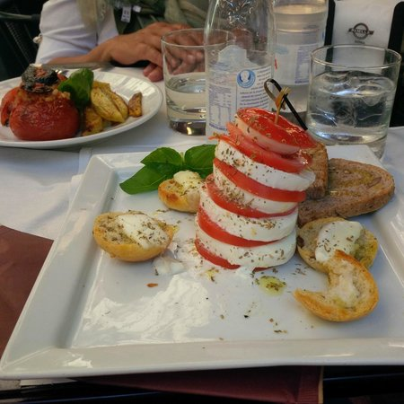 Panella : Amazing Caprese with Bufala Mozzarella, and behind a tomato filled with rice
