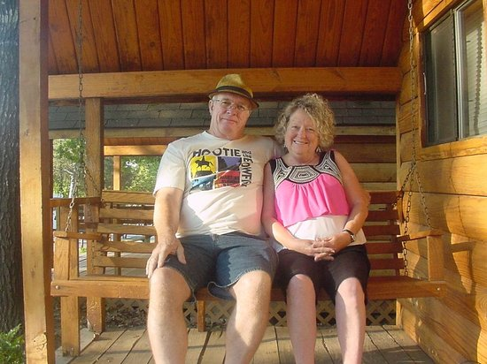Branson KOA & Convention Center: Sitting on the swing in our little log cabin