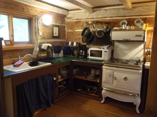 A Captain's Quarters, Galiano's 1894 Heritage Log House: The kitchen has everything you could need.