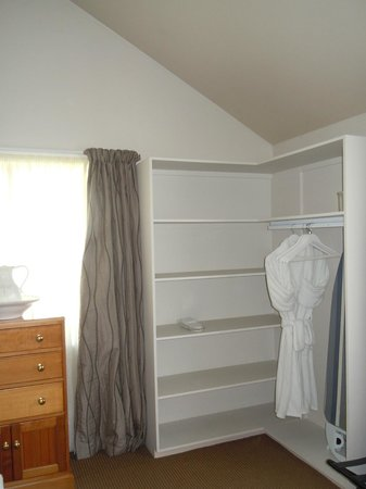 Historic Stone House Boutique Apartments : Corner of bedroom...lots of storage and great robe!